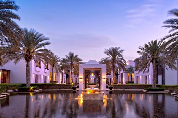 View on the property of The Chedi Muscat at dawn